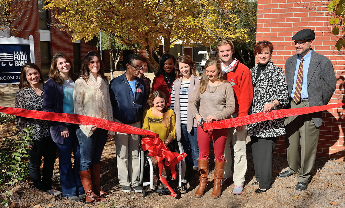Diverse group; Ribbon cutting event for the UM Food Bank